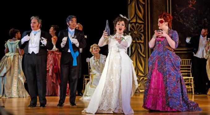 Courtesan Violetta Valéry (Danielle Pastin) raises a toast with her friends Gastone (Eric Ferring), Marquis d'Obigny (Andy Berry) and Flora (Leah de Gruyl). Photo via David Bachman.