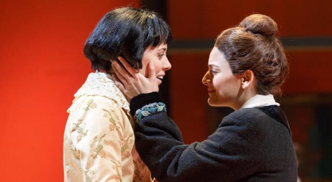 Alice Toklas (Adelaide Boedecker) and Gertrude Stein (Laurel Semerdjian) share a tender moment in their apartment at 27 Rue de Fleurus
