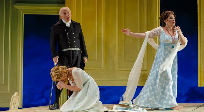 Don Alfonso tells Dorabella and Fiordiligi their fiancees have been called off to war. Photo: David Bachman Photography