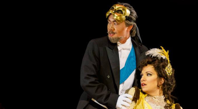 Brian Vu performs as Baron Douphol in La traviata