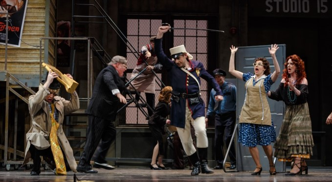 Mayhem! Music teacher Basilio (Brandon Cedel) shields himself from an assault by Count Almaviva (Michele Angelini), who is disguised as Lindoro disguised as a drunken soldier. Photo by David Bachman.