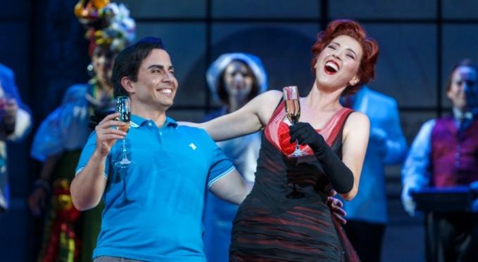 Ernesto (Javier Abreu) and Norina (Lisette Oropesa) toast to their future. Photo: David Bachman