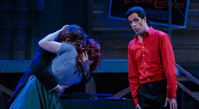 """""""Well, this is awkward."""" Studio hair stylist Figaro (Jonathan Beyer) feels a little out of place as Almaviva (Michele Angelini) and Rosina (Corrie Stallings) share a long-awaited kiss. Photo by David Bachman."""