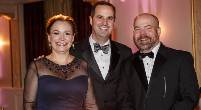 Board member Steve Seibert (right) with Sari Gruber and Bill Powers at the 2015 Diamond Horseshoe Ball.