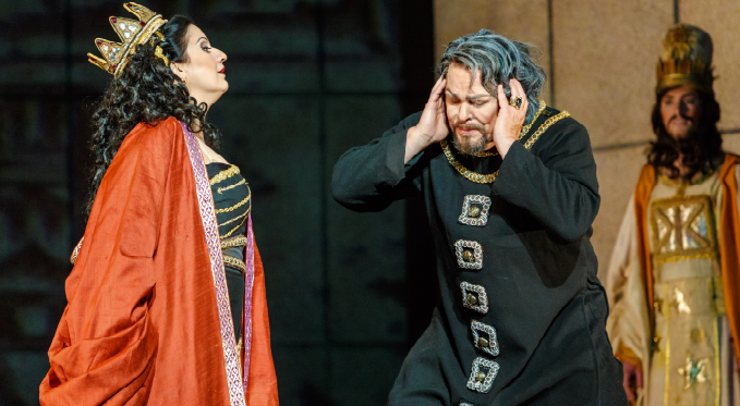 Abigaille (Csilla Boross) sends Nabucco (Mark Delavan) back to prison after denying his request for clemency for his daughter Fenena.
