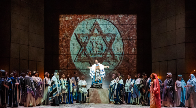 The high priest Zaccaria (Oren Gradus) leads the Israelites (Pittsburgh Opera Chorus and Supernumeraries) in prayer for protection from Nabucco.