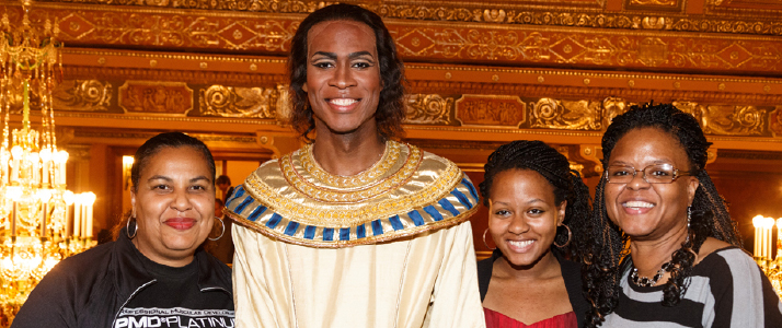Aida cast member Phillip Gay (center) meets an Opera Connections family.