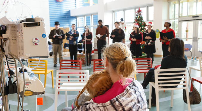 The Resident Artists entertain kids and their families at Children's Hospital at holiday time.