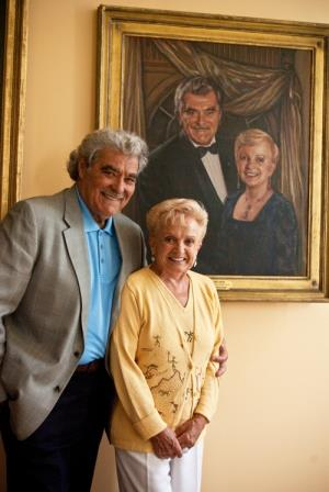 Tito and Gigi Capobianco in front of their portrait at Pittsburgh Opera Headquarters