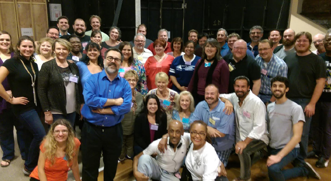 Mark Trawka (foreground) with members of the Pittsburgh Opera Chorus, at a rehearsal for Nabucco.