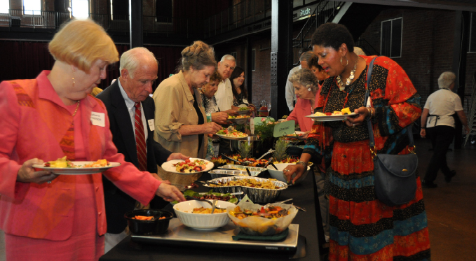 Scenes from one of our Volunteer Stars dinners. Volunteers enjoy a catered meal, entertainment, fellowship, and prizes.