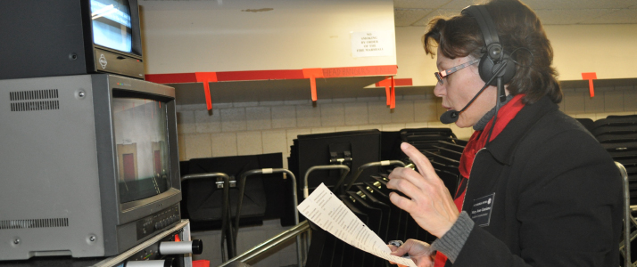 Mary Ann Graziano reads a description of a scene as part of Audio Commentary.