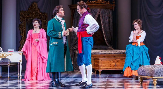 Count Almaviva (Christian Bowers) confronts Figaro (Tyler Simpson) about a secret admirer letter he received.