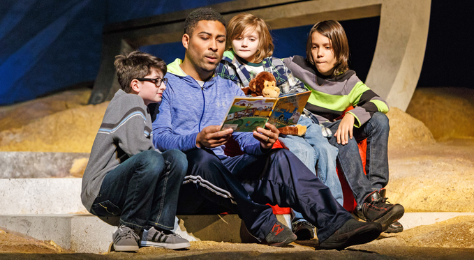 Brian (Ben Taylor) tries to read his boys Virgil, Martin, and Samuel (Simon Nigam, Harrison Salvi, River Beckas) a bedtime story.